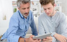 Dad and Son looking at iPad